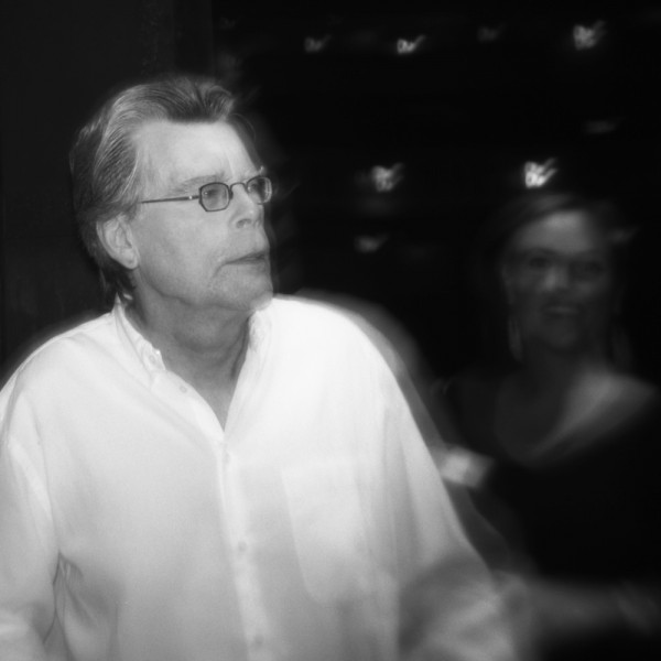 Stephen King at the Majestic Theater with Liza Collins in background (Holga, Kodak 400 TMAX)